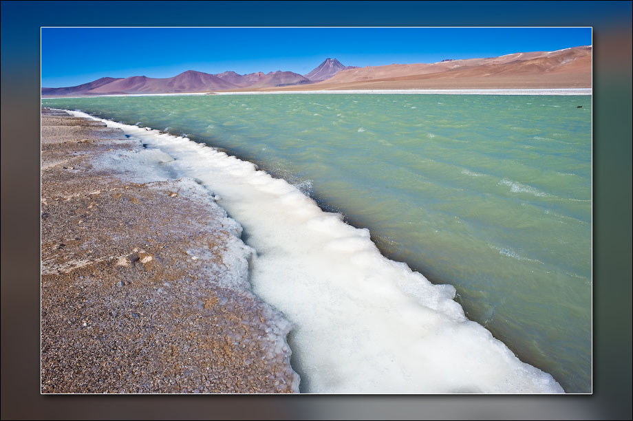 Lake in the Andes. As water is blown out of the lake, it freezes onto the shoreline.