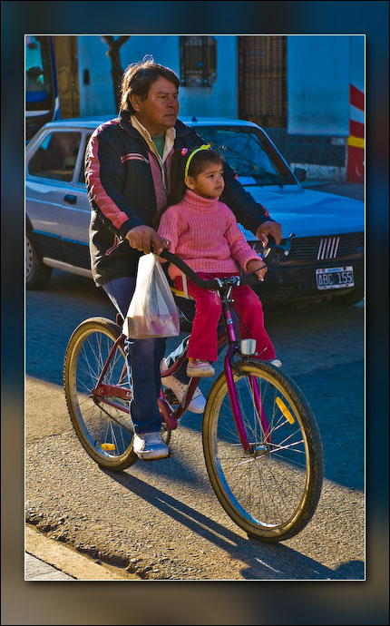 Father and daughter, getting around in Corrientes.