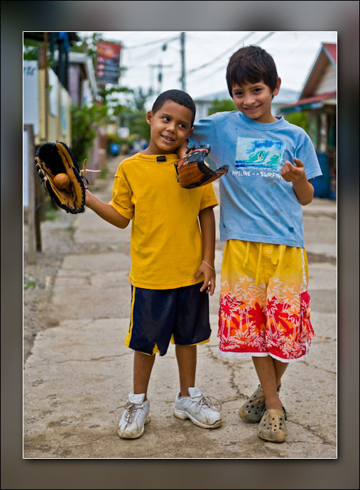 Boys playing catch with a mandarine.
